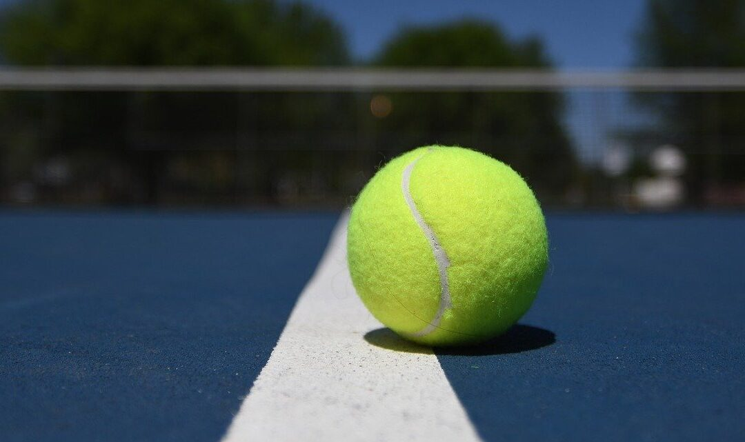 Tennis on Blue Court with Ball